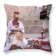 Sewing Souvenirs In Old Dubrovnik Throw Pillow