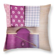 Sewing Threads Needle And Fabrics On A Wooden Box Throw Pillow