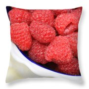 Side View Of Rasberries In Blue Bowl Throw Pillow