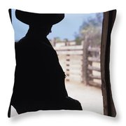 Silhouette Of A Cowboy In A Doorway Throw Pillow