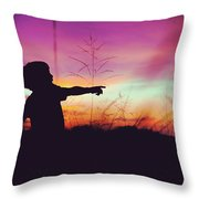 Silhouette Of A Playful Boy Pointing With Finger In The Field During Beautiful Sunset Throw Pillow