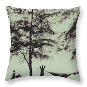 Silhouette Of A Young Men With Crossed Hands Above His Head Camping Hammocking In The Nature Throw Pillow