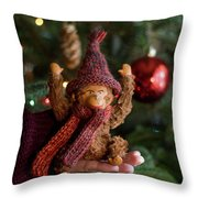 Silly Old Monkey Toy In A Child Hands Under The Christmas Tree Throw Pillow