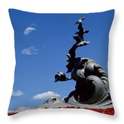 Statue And Tulips Against A Clear Blue Throw Pillow