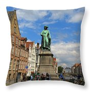 Statue Of Jan Van Eyck Beside The Spieglerei Canal In Bruges Throw Pillow