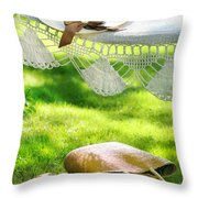 Straw Hat With Brown Ribbon Laying On Hammock Throw Pillow by Sandra Cunningham
