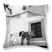 street in Porto with hanging clothes Throw Pillow