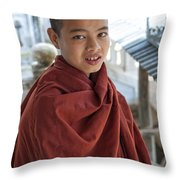 Street Portrait Of A Young Monk Throw Pillow
