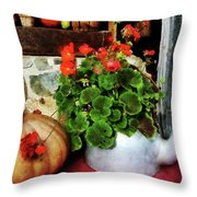 Teapot Filled With Geraniums Throw Pillow