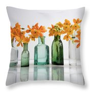 the Blooming yellow Ornithogalum Dubium in a transparent bottle instead vase Throw Pillow