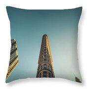 The Flatiron Building Towering Over Manhattan Throw Pillow