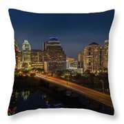 The Glimmering Neon Lights Of The Downtown Austin Skyscrapers Illuminate The Skyline Over Lady Bird Lake Throw Pillow