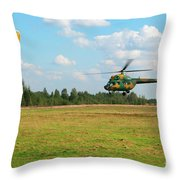 The Helicopter Over A Green Airfield. Throw Pillow