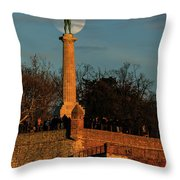 The Moon Rising Behind The Victor Statue In Belgrade In The Golden Hour Throw Pillow