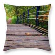 the old bridge over the river invites for a leisurely stroll in the autumn Park Throw Pillow