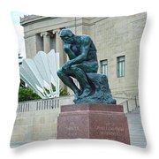 The Thinker And The Shuttlecock Throw Pillow