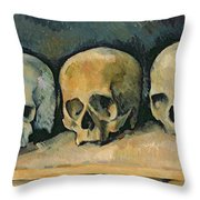 The Three Skulls Throw Pillow by Paul Cezanne