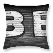 The Word Be Painted On The Side Of Old Building Throw Pillow