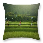 Three Boys Are Happy To Play Kites At Summer Field In Nature In  Throw Pillow