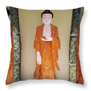 Three Buddha Statues Throw Pillow