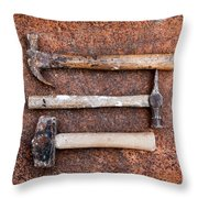 Three Hammers Against A Rust Background Throw Pillow