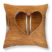 Three Heart Cutters Throw Pillow