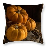 Three Pumpkins On A Bucket Throw Pillow