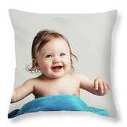 Toddler With A Cozy Blanket Sitting And Smiling. Throw Pillow