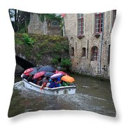 Tourists With Umbrellas In A Sightseeing Boat On The Canal In Bruges Throw Pillow