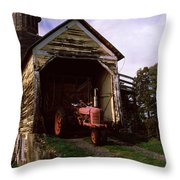 Tractor Parked Inside Of A Round Barn Throw Pillow