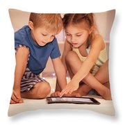 Two Happy Children Playing On The Tablet Throw Pillow