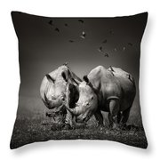 Two Rhinoceros With Birds In Bw Throw Pillow