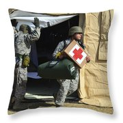 U.s. Air Force Soldier Exits A Medical Throw Pillow