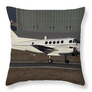 U.s. Army C-12 Huron Liaison Aircraft Throw Pillow by Timm Ziegenthaler