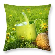 Watering Can In The Grass Throw Pillow by Sandra Cunningham