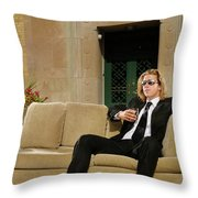 Wealthy Young Man In Suit Sitting On A Couch With A Drink On A T Throw Pillow