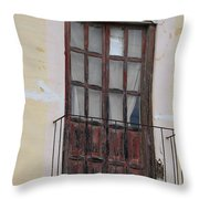 Weathered Red Door On A Balcony Throw Pillow