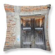 Weathered Wood Door In An Adobe Brick Wall Throw Pillow