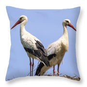 White Storks Throw Pillow by Wim Lanclus