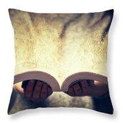Woman Holding An Open Book Bursting With Light. Throw Pillow