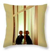 Woman In Soft Light Reflected Throw Pillow