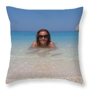 Woman In Water Enjoying Navagio Beach On The Island Of Zakinthos Throw Pillow
