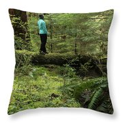 Woman On A Moss Covered Log In Olympic National Park Throw Pillow