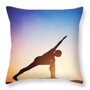 Woman Standing In Revolved Side Angle Yoga Pose Meditating At Sunset Throw Pillow
