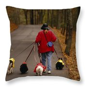 Woman Walks Her Army Of Dogs Dressed Throw Pillow