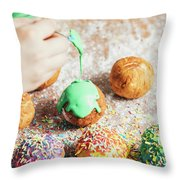 Woman's Hand Coating A Donut With Green Frosting. Throw Pillow