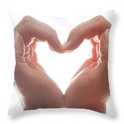 Woman's Hands Make A Heart Shape On White Background, Backlight. Love Throw Pillow