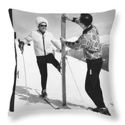 Women Waxing Skis Throw Pillow