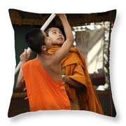 Young Buddhist Monks Laos Throw Pillow