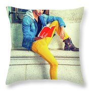 Young Man Reading Red Book, Sitting On Street Throw Pillow